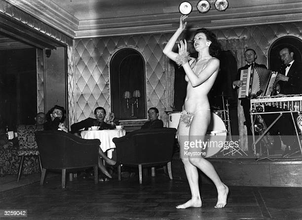 Velina Vellona performs her veil dance at the Piccadilly Nightclub on the Kurfustendam in Berlin