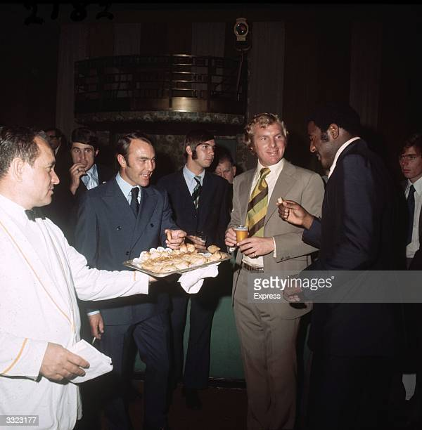 West Ham United footballers enjoy a selection of snacks at a social function Left to right Jimmy Greaves Peter Grotier Bobby Moore Clyde Best and...