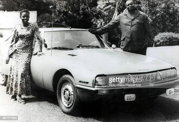 circa 1970's President Idi Amin of Uganda and his 5th wife Sarah who had been dubbed Suicide Sarah standing next to a Citroën SM coupé