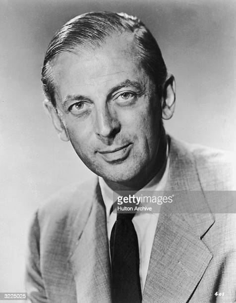 Headshot portrait of British journalist broadcaster and television host Alistair Cooke