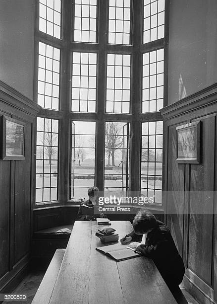 Schoolboys at Christ's Hospital London studying in a panelled room with a large mullioned window