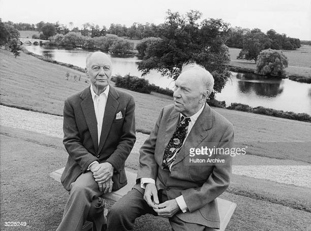 Britishborn actors John Gielgud and Ralph Richardson sitting on a bench by a river