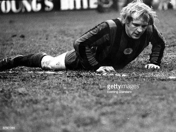 Footballer Francis Lee lying on the pitch during a game between Crystal Palace and Manchester City