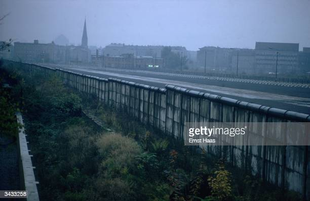 The Berlin Wall which cuts through the city dividing East from West In Germany book
