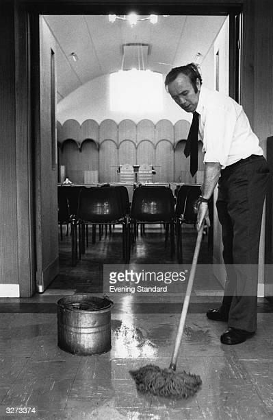 A cleaner mopping the floor of the London Hospital Whitechapel
