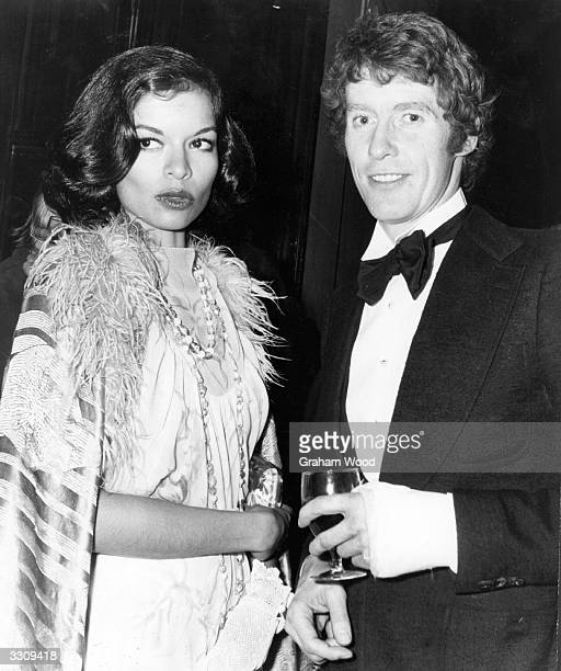 Actor Michael Crawford with Bianca Jagger at a party after the first night of 'Billy' at the Drury Lane Theatre in London