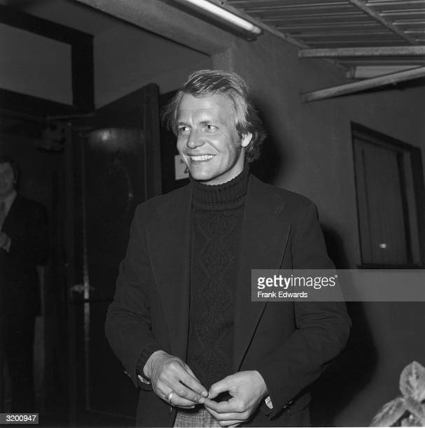 American actor and pop singer David Soul smiles while attending the opening night performance of Gardner McKay's play 'Sea Marks' He wears a dark...