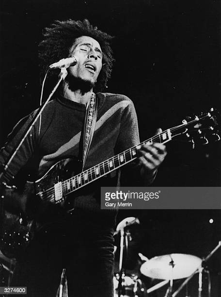 Bob Marley , the singer, guitarist and composer of reggae music in concert.