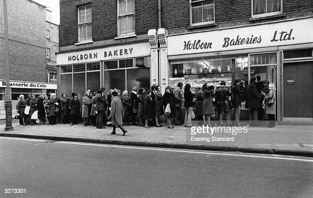 People queuing at the Holborn bakery in Lambs Conduit Street, for the next delivery of bread during the Industrial dispute.