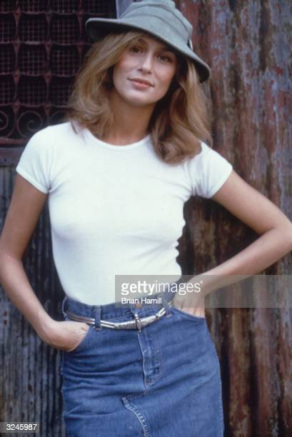 Portrait of American model and actor Lauren Hutton wearing a hat a white Tshirt and a denim skirt