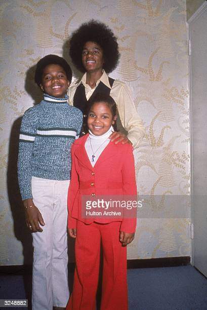 Singers and siblings Michael Janet and Randy Jackson pose together