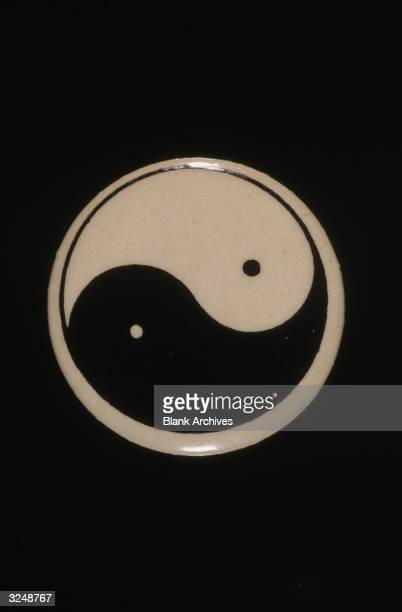 A button featuring the Chinese cosmological symbol Yinyang
