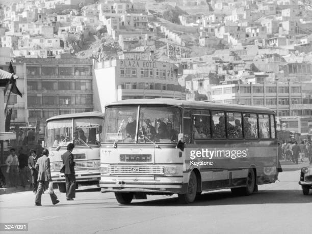 Crowded bus on a street near the PLaza Hotel in Kabul, Afganistan.