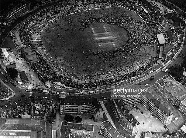 Large crowd on the pitch at the Oval cricket ground in Kennington, London.