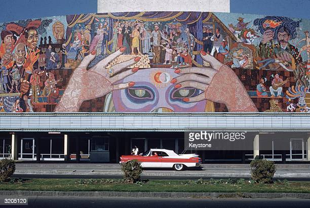 A vibrant mosiac by Diego Rivera covers the side of a theatre on Insurgents Boulevard in Mexico City