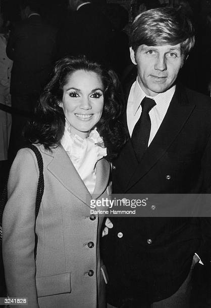 American actor Gary Collins and his wife former Miss America Mary Ann Mobley standing together and smiling during an unidentified event Collins is...