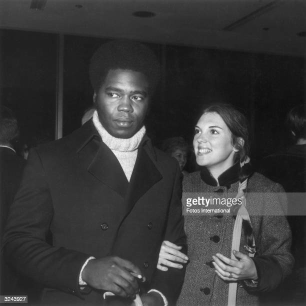 American actor Tyne Daly and her husband Cubanborn actor George Stanford Brown attend a performance of the British National Theatre London England...