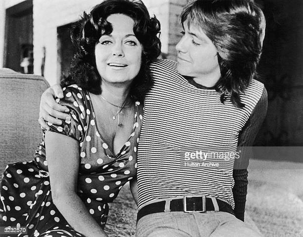 American singer and actor David Cassidy sits with his arm around his mother actor Evelyn Ward David wears a striped shirt and his mother wears a...