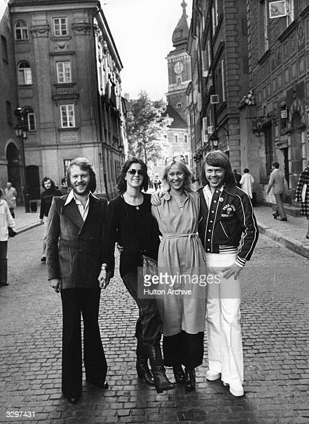 Benny Annafrid Agnetha and Benny swinging Swedish pop group Abba loitering in a cobbled street