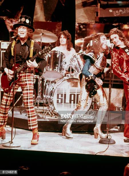 Circa 1975 British rock band Slade perform on stage for the television variety series 'The Midnight Special' 1970s Left to right singer Noddy Holder...
