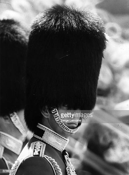 Charles, Prince of Wales wearing a bearskin as Colonel in Chief of the Welsh Guards during a Trooping Of The Colour ceremony at Horse Guards Parade,...