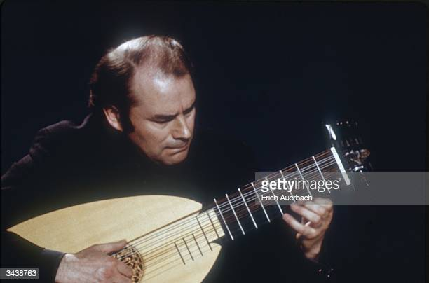 English classical guitarist Julian Bream playing a lute