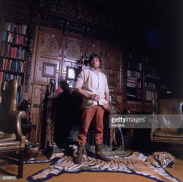 Famous hell raiser Oliver Reed at home in his 18th century mansion Broome Hall near Dorking in Surrey The £60000 property has 45 bedrooms