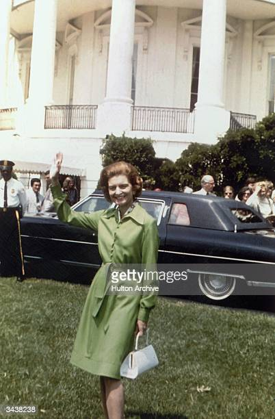First Lady Betty Ford wife of Gerald R Ford the 38th President of the United States waves to photographers from the lawn of the White House...