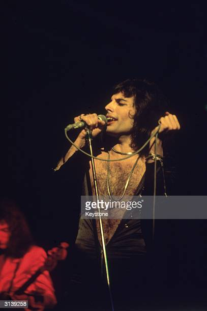 Freddie Mercury lead singer of 70s hard rock quartet Queen in concert during the group's British tour