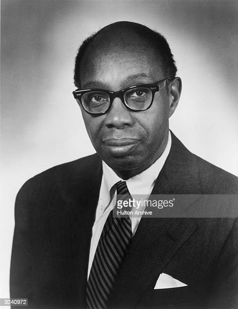 Headshot studio portrait of Pulitzer Prize-winning composer and pianist, George Walker, wearing glasses and a jacket and tie.