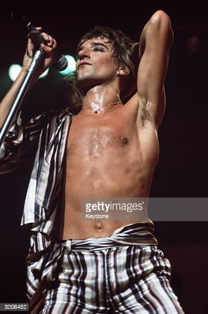 London born rock star and singer Rod Stewart in concert with 'The Faces'