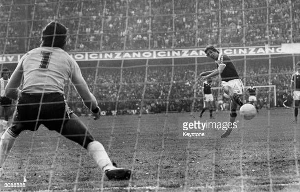 Masson of Scotland scores fromt he penalty spot during a match between Scotland and Argentina which ended ina draw at the Boca Stadium in Buenos Aires