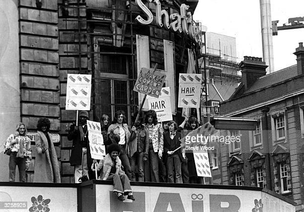 Members of the cast of Hair the musical demonstrating outside the Shaftesbury Theatre in Shaftesbury Avenue London in a bid to save the old Covent...
