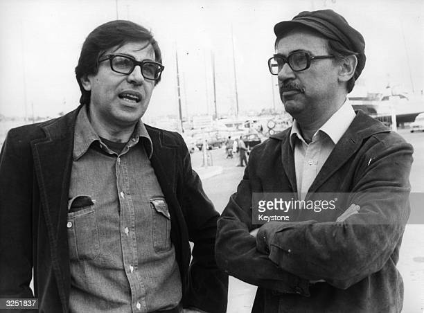 Paolo and Vittorio Taviani chatting at the Cannes Film Festival Their film 'Padre Padrone' which represented Italy won the coveted Palme d'Or