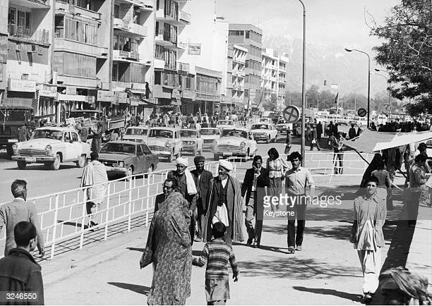 Pedestrians and traffic on a street in Kabul Afganistan