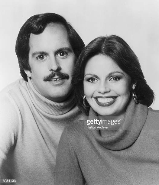 Promotional headshot portrait of married American pop singers the Captain and Tennille wearing turtleneck sweaters. Their biggest hit was 'Love Will...