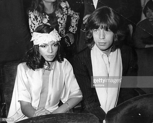 Rock singer Mick Jagger of the Rolling Stones with his wife Bianca at the opening night of 'Josephine' a new show by Andrew Levasseur on the leftbank...