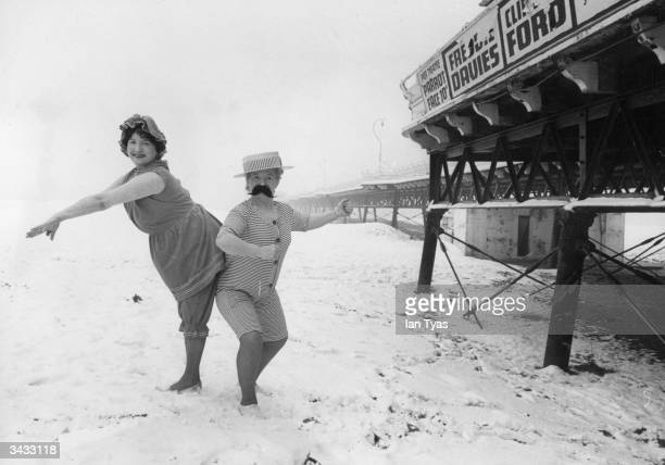 Skegness landladies Hazel Adams and Marjorie Romanis wearing 1914 bathing costumes on the beach in the snow for publicity photographs