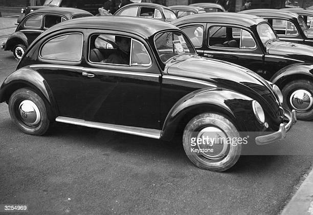 Volkswagen Beetle cars parked