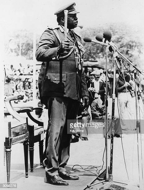 President of Uganda Idi Amin speaking at an outdoor rally and brandishing his baton of office