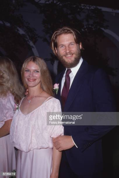 American actor Jeff Bridges and his wife Susan Geston smiling while at a formal event Bridges is wearing a navy blue suit and has a beard Geston is...