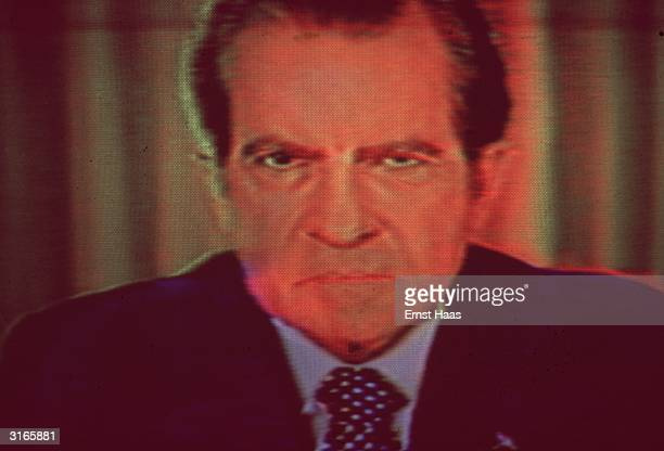 President Nixon comes across an angry crowd while campaigning in Michigan during the height of the Watergate scandal