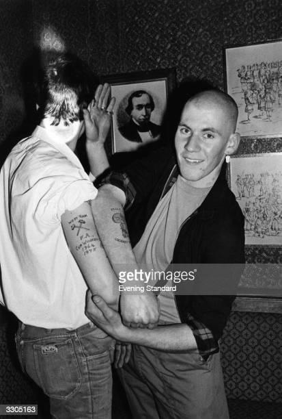 Skinhead Nicci Crane and his friend showing off their football tattoos