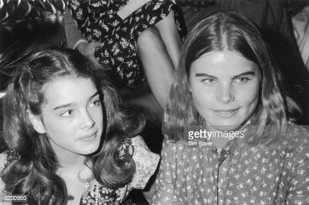 Headshot of American actors Brooke Shields and Mariel Hemingway sitting together at an Oscars party in the Studio 54 nightclub in New York City Both...
