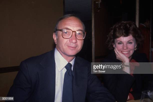 American playwright Neil Simon with his second wife American actor Marsha Mason seated at a table