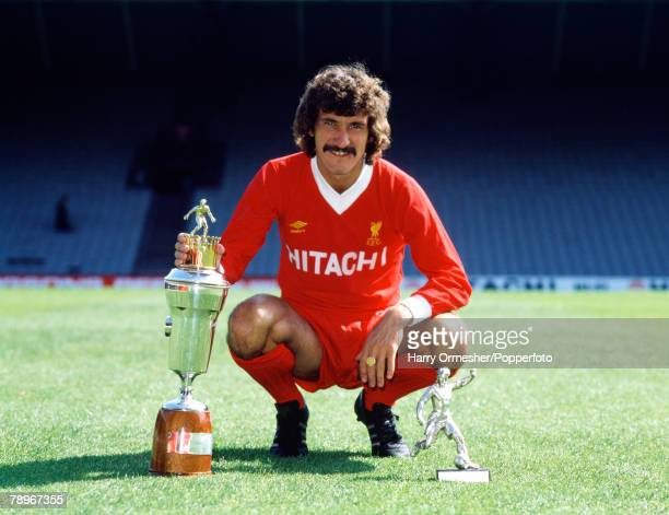 Circa 1980 Anfield Liverpool Liverpool FC player Terry McDermott poses with two player trophies
