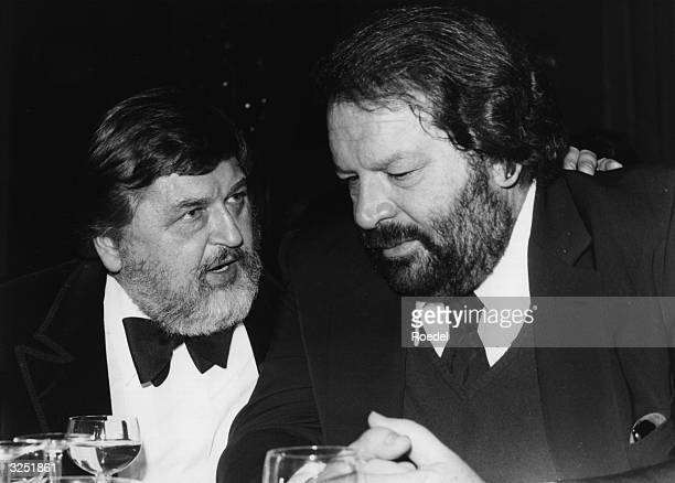 Italian star of Western movies Bud Spencer on the right is in deep conversation with film producer Horst Wendlandt The two men were at a carnival in...