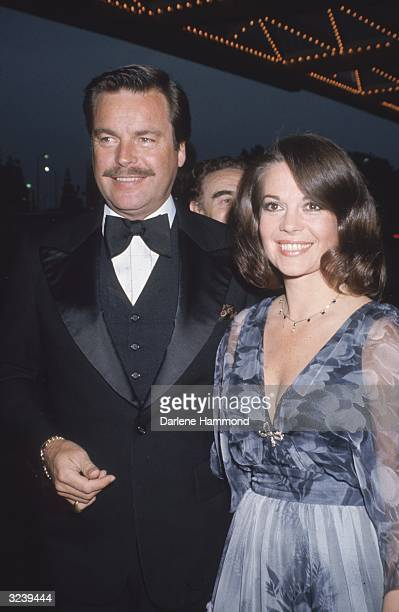 Married American actors Natalie Wood and Robert Wagner attending a formal event Wood is wearing a blue dress with powderblue sheer sleeves and a...