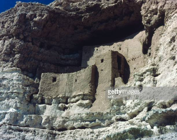 Montezuma Castle, an ancient structure built into a limestone cliff-face in Verde Valley, Arizona by the Sinagua, a tribe of the Western Anasazi who...
