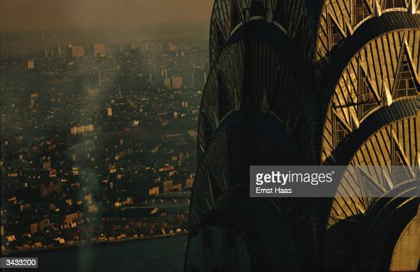 Part of the tower of the Art Deco Chrysler building in Manhattan outlined against the city landscape Image Appears HaasCD